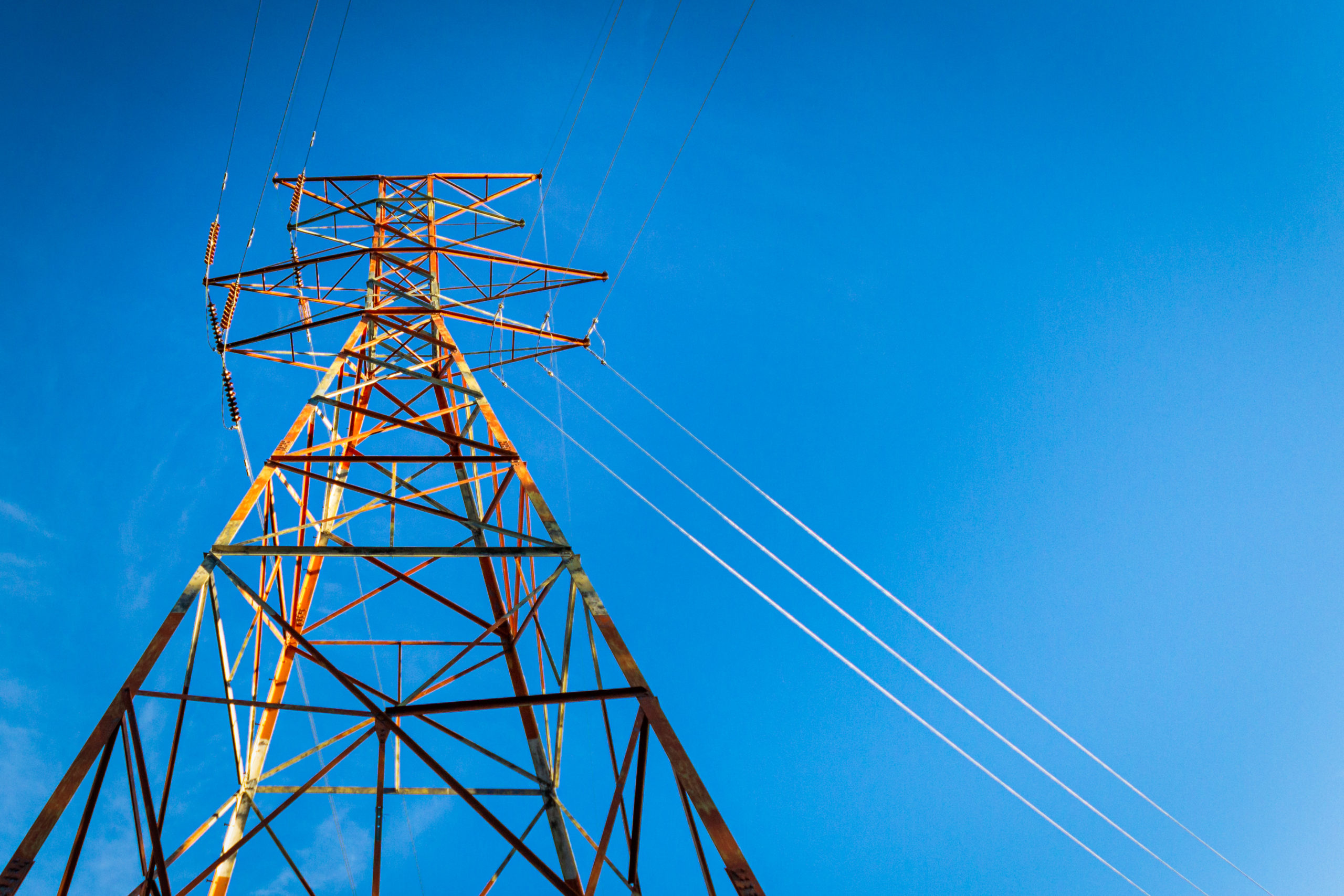 Electrical wires against blue sky, Maine, USA.